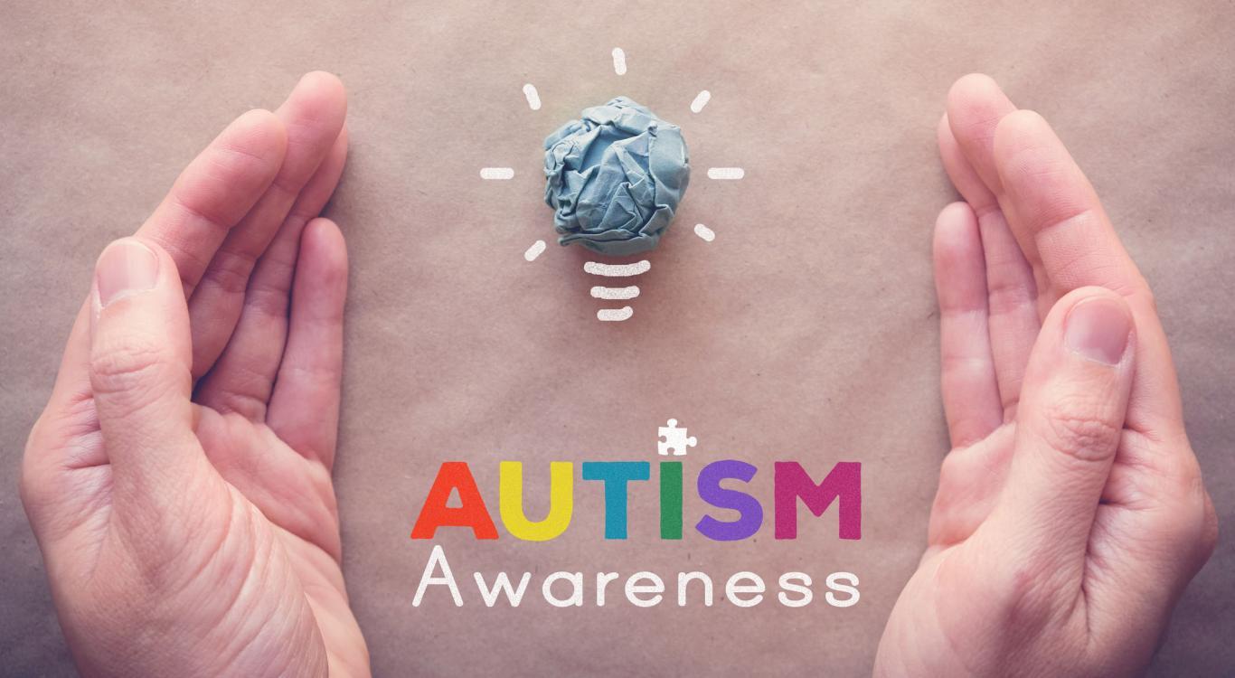 hands surrounding Autism