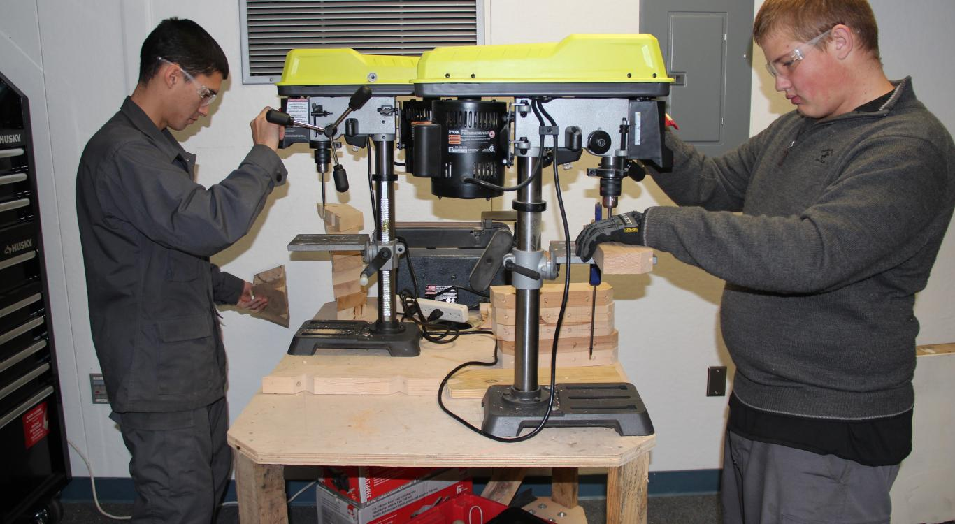 Stanislaus Military studens using table saw