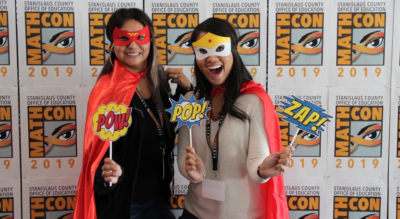 two ladies in superhero costume