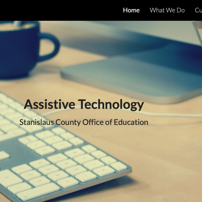 screenshot of the assistive technology webpage showing a keyboard and pencil jar