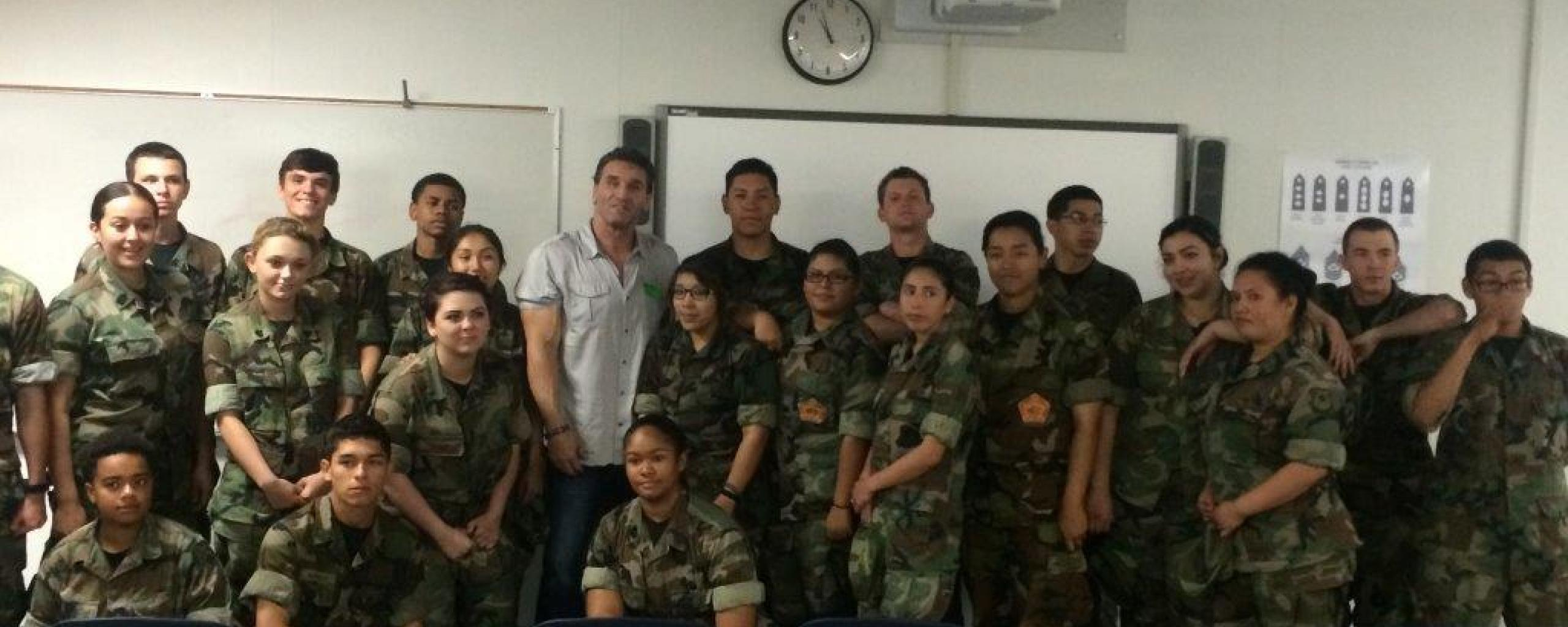 character education students standing with advisor in classroom
