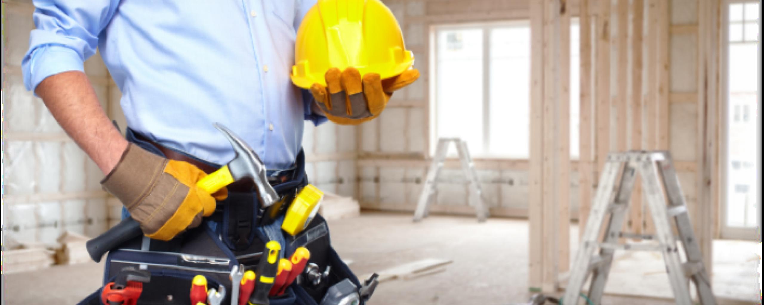 Construction worker, framed building