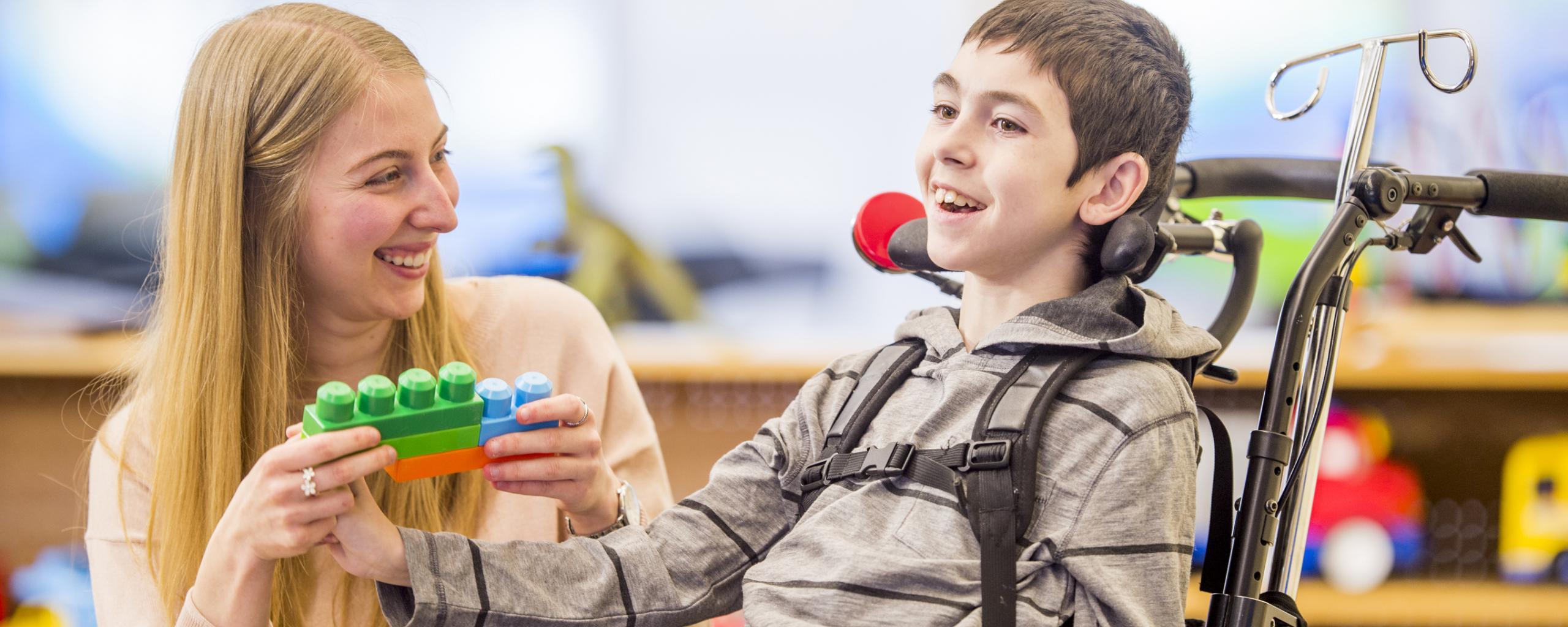 Teacher with boy in wheelchair