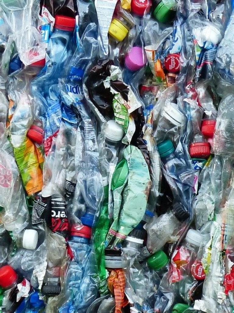 a photo showing crushed plastic bottles