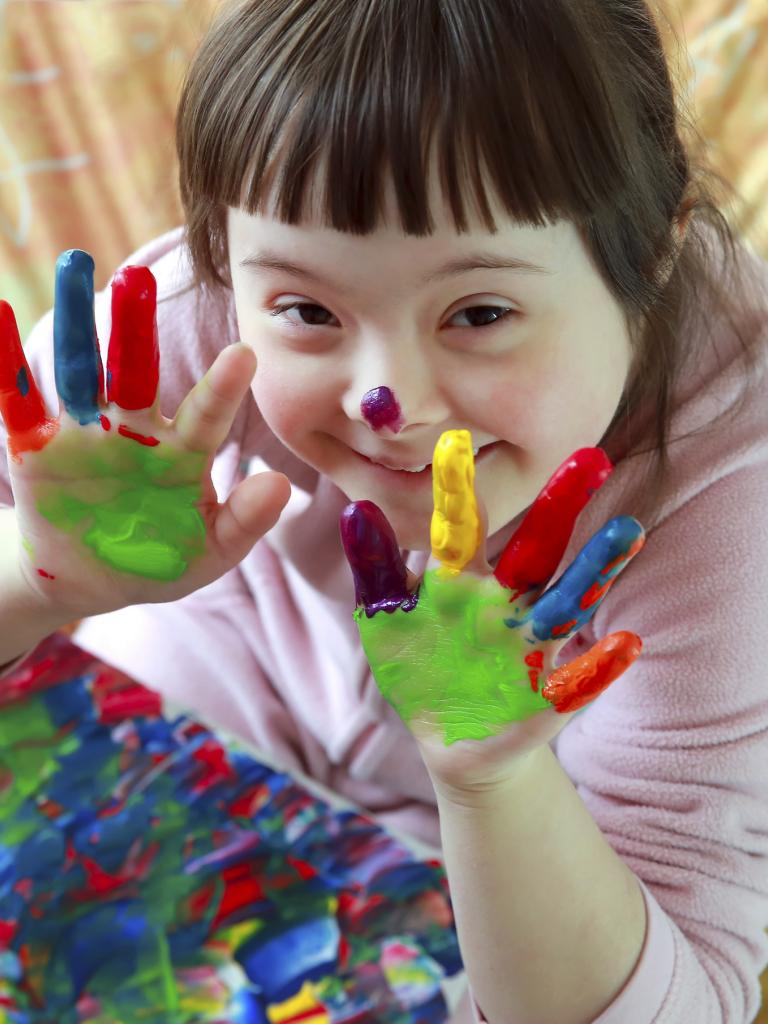 Downs Girl with Paint on Hands
