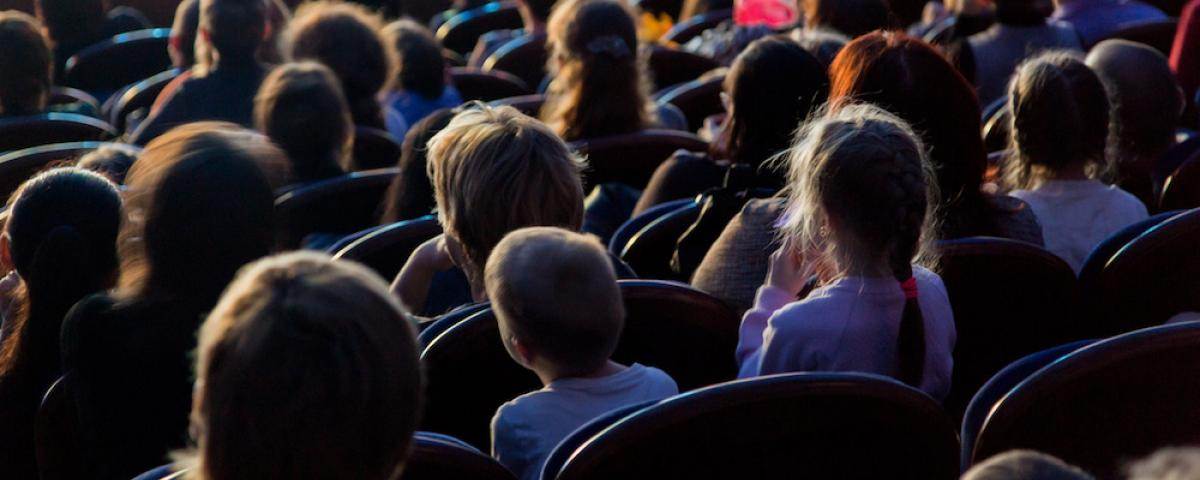 Children seated in theater