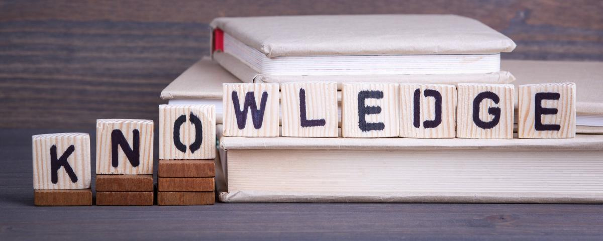 scrabble tiles spell out the word knowledge