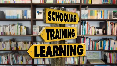 "School Sign in a library with the words ""schooling, training, and learning"""
